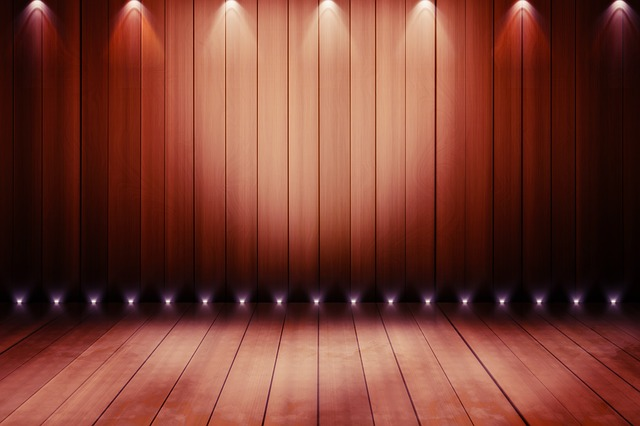 Bare stage with spotlights and stage curtains